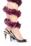 Legs and black high heels. Ladies' Legs with christmas decorations and black high heel shoes Royalty Free Stock Photos