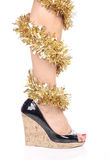Legs and black high heels. Legs with christmas decorations and black high heel shoes Royalty Free Stock Image