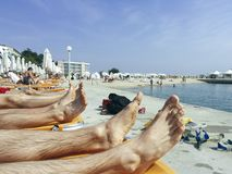 Legs on the black sea beach in Bulgaria royalty free stock images