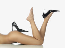 Legs in black shoes Stock Photos