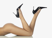 Legs in black shoes Stock Images