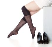 Legs in black stockings Stock Image