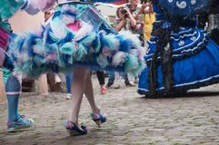Legs and blue dress of Costumed woman at the Venetian Parade in Riquewihr in Alsace. RIQUEWIHR - France - 1 July 2017 - closeup of legs and blue dress of Royalty Free Stock Photo