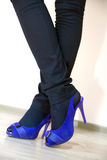 Legs in blue shoes Royalty Free Stock Images