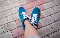 Legs in blue shoes Royalty Free Stock Photos