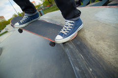 Legs and the board skateboarder at start. Close-up. Royalty Free Stock Photo