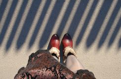 Legs in boots Stock Photography