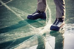 Legs in boots on the ice Stock Photography