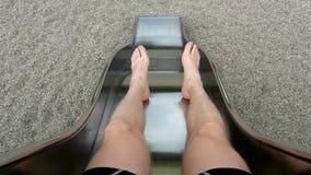 Legs of boy on metal slider. Movement of body. stock video