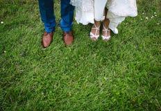 Legs bride groom green grass summer royalty free stock photos