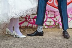 Legs of bride and groom. Groom and bride standing near each other, showing shoes and socs Royalty Free Stock Images