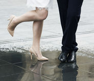 Legs of bride and groom on wedding day, conceptual photo of marriage Royalty Free Stock Images
