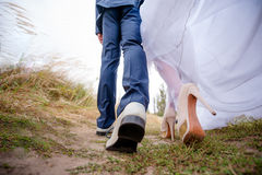 Legs brides and groom, newlyweds walk Royalty Free Stock Image