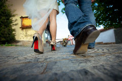 Legs brides and groom Stock Images