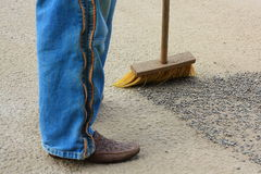 Legs and broom. Legs broom gravel rock female dust stock photography
