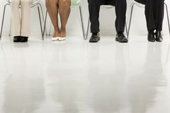 Legs of business people. Legs of multi-ethnic business group of men and women sitting Royalty Free Stock Photography