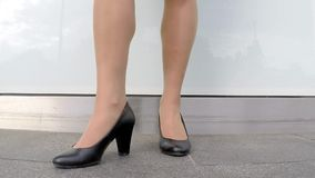 Legs of business woman over the wall in the city. stock video footage