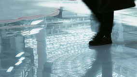 Legs of businessmen hurrying to a meeting in a corporation stock video footage