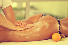 Legs and buttocks massage in the spa center oranges Stock Images