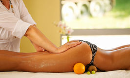 Legs and buttocks massage in the spa center Stock Image