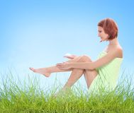 Legs care outdoors Stock Photography