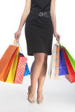 Legs of Caucasian Woman With Shopping Bags Royalty Free Stock Images