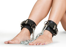Legs Chained. On White Background Isolated royalty free stock images