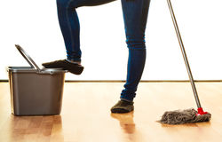 Legs of cleaning woman with mop bucket Stock Photography