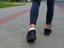 Legs close-up teenager walking down the royalty free stock images