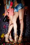 Legs of clubbers Royalty Free Stock Image