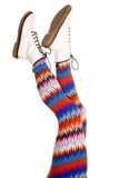 Legs colorful pattern white boots both up Royalty Free Stock Photos