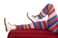 Legs colorful pattern white boots lay one bent Stock Photos
