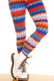 Legs colorful pattern white boots stand one toe Royalty Free Stock Photo
