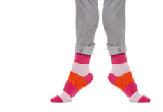 Legs in colorful striped socks. Close up Royalty Free Stock Images