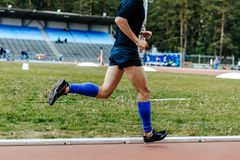 Legs in compression socks runner athlete. On track stadium Royalty Free Stock Photo