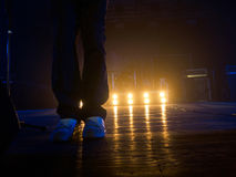 Legs on the concert stage Stock Photography