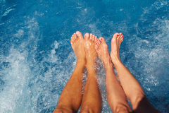 Legs of coouple in jacuzzi. Legs of couple in jacuzzi. Spa and relaxation background Stock Photography