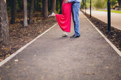Legs of a couple kissing at the park Royalty Free Stock Photo