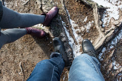 Legs of couple man and woman wearing shoes and standing on ground Royalty Free Stock Images