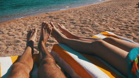 Legs of Couple People Lying on Beach Sun Lounger near the Red Sea stock video footage