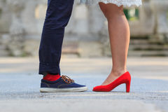 Legs of a couple standing opposite each other Stock Images