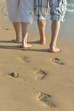 Legs of couple walking Stock Images