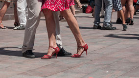 Legs of couples of tango dancers on main place with o. Closeup of legs of couples of tango dancers on main place with other dancers at the spring tango festival stock image