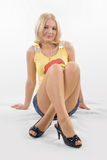 Legs crossed in miniskirt Stock Images