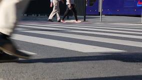 Legs of crowd people walking on the pedestrian crossing. Close-up of crowd feet. City crowd. Many legs walking along the sidewalk stock video footage