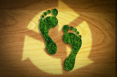 Legs cut reusable, Reduce, Recycle concept. On green grass stock illustration