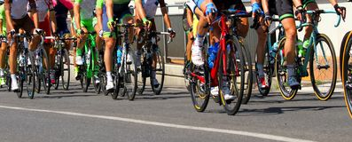 Legs of cyclists who ride during the race Stock Photography