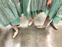 Legs of dancer in pointe shoes in the backstage. Legs of dancer in costume and pointe shoes in the backstage stock photography