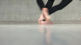 Legs of dancers performing dance moves. Low section of contemporary style dancers dancing in studio. Couple of dancers working out stock video footage