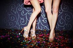 Legs of dancers. Legs of two girls dancing in night club royalty free stock image
